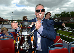 Bristol Rovers Stadium Manager, Ian Holtby with the Vanarama Conference Play-Off Final trophy  - Photo mandatory by-line: Dougie Allward/JMP - Mobile: 07966 386802 - 25/05/2015 - SPORT - Football - Bristol - Bristol Rovers Bus Tour