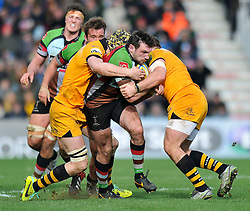 Tom Guest (Harlequins) is double-tackled in possession - Photo mandatory by-line: Patrick Khachfe/JMP - Tel: Mobile: 07966 386802 09/02/2014 - SPORT - RUGBY UNION - The Twickenham Stoop, London - Harlequins v London Wasps - Aviva Premiership.
