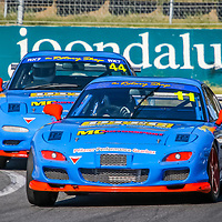 Kerry Wade (11 - Mazda RX7) leads Matt Cherry (44 - Mazda RX7) onto the main straight at Wanneroo Raceway.