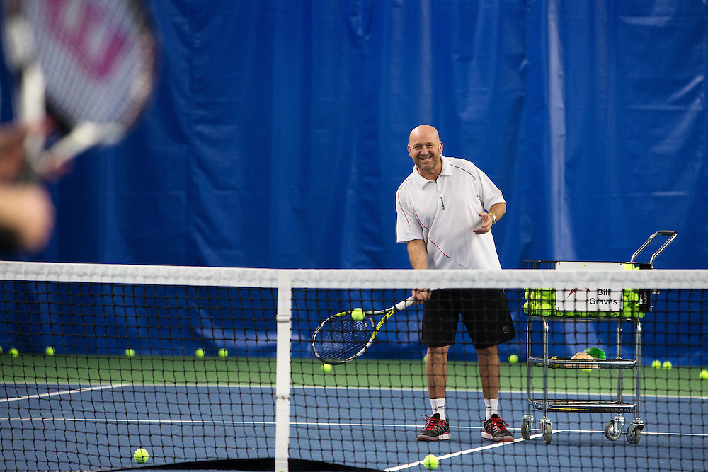 GABE GREEN/Press<br /> <br /> Bill Graves, tennis director at Peak Tennis in Coeur d&rsquo;Alene, warms up with a student Tuesday. Graves was the first person to play on the new courts at Peak.