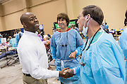 U.S Senator Tim Scott greets volunteer dentists during a free medical mission held by the SC Dental Association August 23, 2013 in North Charleston, South Carolina. More than 1,000 people showed up to receive free dental and medical care.