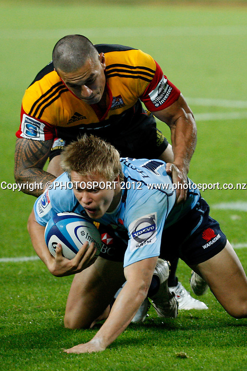 Sonny Bill Williams gets behind Waratahs Tom Kingston in action during their game at Waikato Stadium  2012 Super Rugby season, Chiefs v Waratahs at Waikato Stadium, Hamilton, New Zealand, Saturday 31 March 2012. Photo: Dion Mellow/photosport.co.nz