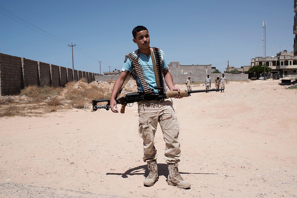 Libya: A Libya's Government of National Accord's (GNA) fighter on the frontline with ISIS in Sirte. Alessio Romenzi