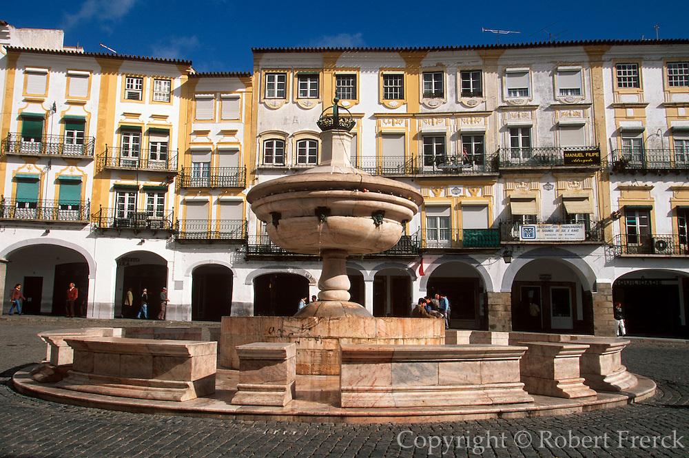 PORTUGAL, ALENTEJO AREA Evora, buildings lining the Praca Do Giraldo, the town's main square