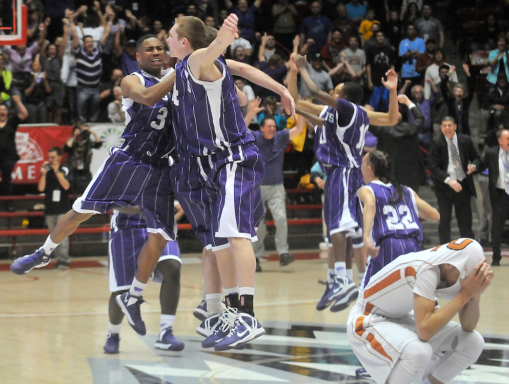 gbs031413l/SPORTS/Greg Sorber -- Clovis' Kamal Cass, 3, and Drew Cole, left, jump for joy as Eldorado's Zach Lee pulls his jersey over his head, right, after Clovis won the 5A State Basketball semi-final game, 69-66 in overtime in the Pit on Thursday, March 14, 2013.