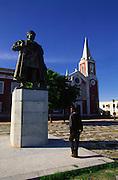 Boy walks near the statue of portuguese navigator Vasco da Gama on the Square where is also build Saint Paul Palace-Museum . Vasco da Gama was Mozambique discoverer