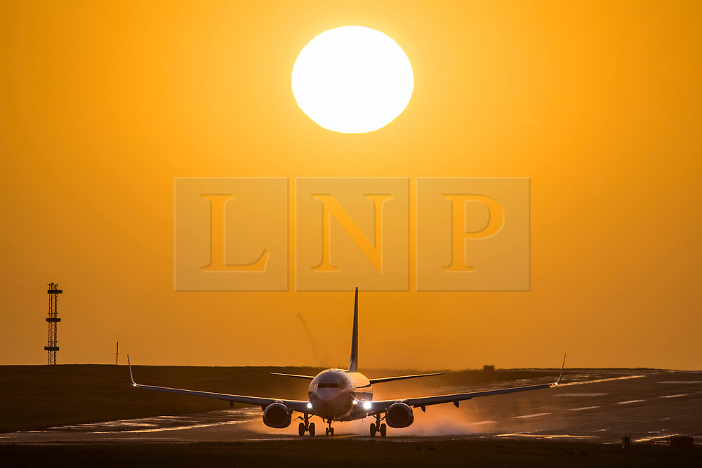 © Licensed to London News Pictures. 08/12/2019. Leeds UK. An aircraft takes off from Leeds Bradford airport as the sun rises this morning in Yorkshire. Photo credit: Andrew McCaren/LNP