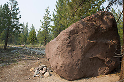 Lava boulder, moved 3 miles down hill after the 1915 eruption, was formed over 27,000 years ago, Lassen Volcanic National Park, California, USA.