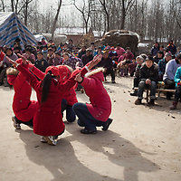 University students perform a religious skit for a village audience during the Chinese New Year holiday.