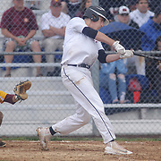 Caravel Academy Alex Barker (34) makes contact with the ball in the mist of the second round of the DIAA baseball state tournament between#4 Caravel Academy and #15 St. Elizabeth Saturday May 27, 2017, at Caravel Academy in Bear Delaware.