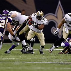 September 9, 2010; New Orleans, LA, USA; New Orleans Saints running back Reggie Bush (25) runs with the ball during the NFL Kickoff season opener at the Louisiana Superdome. The New Orleans Saints defeated the Minnesota Vikings 14-9.  Mandatory Credit: Derick E. Hingle