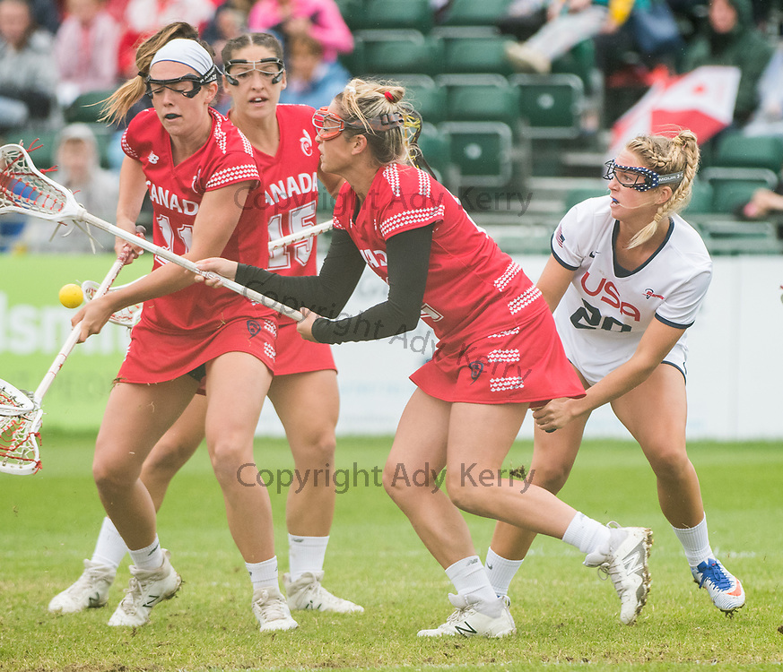 The Canadian defence close out USA's Brooke Griffin(20) at the 2017 FIL Rathbones Women's Lacrosse World Cup at Surrey Sports Park, Guilford, Surrey, UK, 15th July 2017