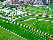 Nederland, Zuid-Holland, Pijnacker-Nootdorp; 14–05-2020; Bergboezem Polder van Oude Leede, ter hoogte van buurtschap Oude Leede, onderdeel van de Berkelse Boezem. De polder, met de Boezemweg,  is een natuurreservaat en tevens voorbestemd als waterberging ofwel een calamiteitenberging. Nieuwbouw Berkel en Rodenrijs in de  achtergrond. <br /> Bergboezem Polder van Oude Leede, near the hamlet of Oude Leede, part of the Berkelse Bosom. The polder is a nature reserve and also destined as a water storage or a calamity storage.<br /> <br /> luchtfoto (toeslag op standaard tarieven);<br /> aerial photo (additional fee required)<br /> copyright © 2020 foto/photo Siebe Swart