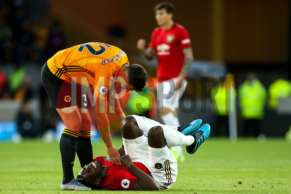 Paul Pogba of Manchester United looks in pain after a collision with Leander Dendoncker of Wolverhampton Wanderers - Mandatory by-line: Robbie Stephenson/JMP - 19/08/2019 - FOOTBALL - Molineux - Wolverhampton, England - Wolverhampton Wanderers v Manchester United - Premier League