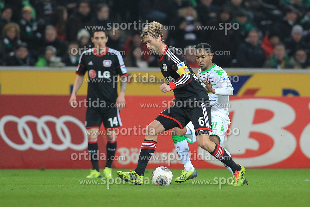 07.02.2014, Borussia Park, Moenchengladbach, GER, 1. FBL, Borussia Moenchengladbach vs Bayer 04 Leverkusen, 20. Runde, im Bild Raffael (Borussia Moenchengladbach #11) im Zweikampf gegen Kapitaen Simon Rolfes #6 (Bayer 04 Leverkusen), Aktion, Action // during the German Bundesliga 20th round match between Borussia Moenchengladbach and Bayer 04 Leverkusen at the Borussia Park in Moenchengladbach, Germany on 2014/02/08. EXPA Pictures &copy; 2014, PhotoCredit: EXPA/ Eibner-Pressefoto/ Schueler<br /> <br /> *****ATTENTION - OUT of GER*****