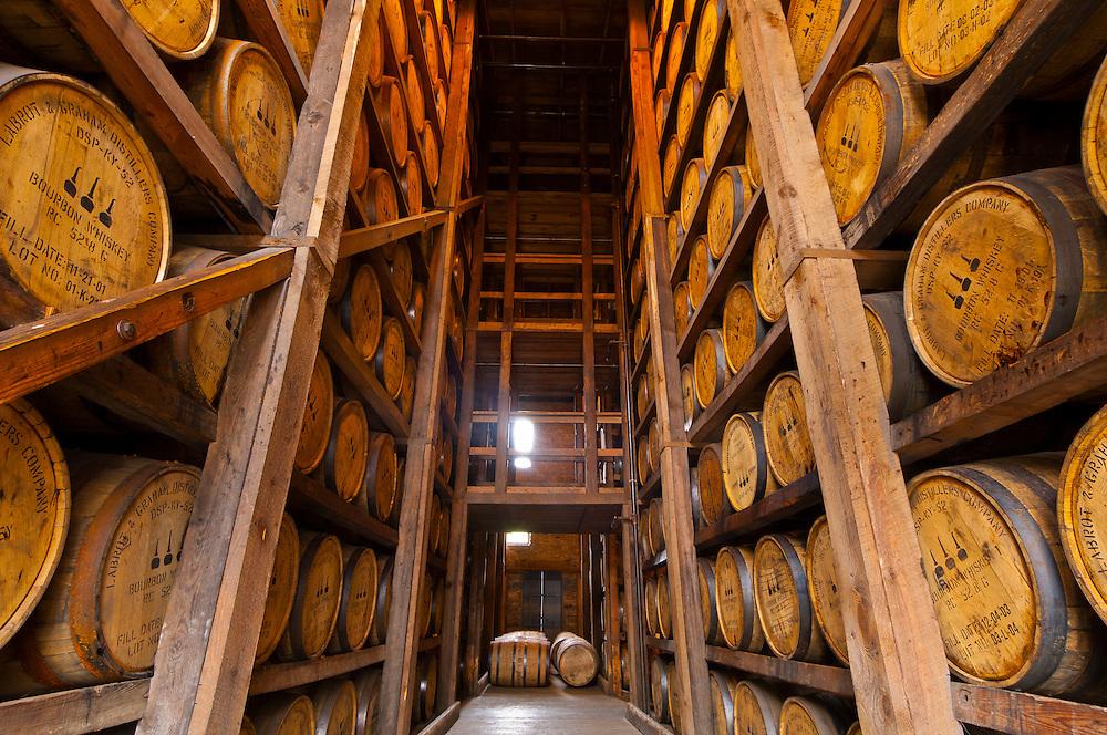 Oak barrels in the aging warehouse made of stone, Woodford Reserve Distillery (premium bourbon), Versailles (near Lexington), Kentucky USA