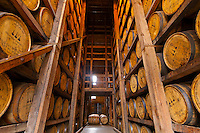 Oak barrels in the aging warehouse made of stone, Woodford Reserve Distillery (premium bourbon), Versailles (near Lexington), Kentucky USA
