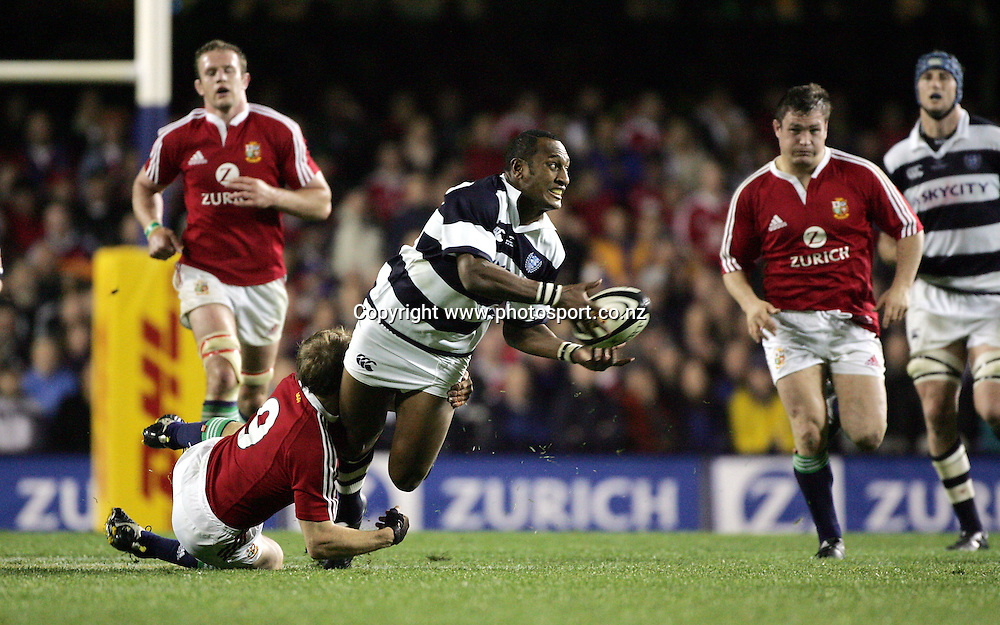 Auckland winger Joe Rokocoko gets his pass away in the tackle of Matt Dawson during the Lions tour match vs Auckland at Eden Park, Auckland,Tuesday 5 July 2005. The Lions won the match 17-13. Photo:Andrew Cornaga/PHOTOSPORT