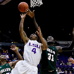 November 24, 2012; Baton Rouge, LA; LSU Tigers guard Corban Collins (4) shoots over Mississippi Valley State Delta Devils center Julius Francis (31) and guard Darius Tomlin (25)during the second half of a game at the Pete Maravich Assembly Center.  LSU defeated Mississippi Valley State 75-50. Mandatory Credit: Derick E. Hingle-US PRESSWIRE