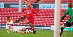 LIVERPOOL, ENGLAND - Saturday, January 8, 2011: Liverpool's Raheem Sterling is hacked down by Crystal Palace's Daniel Pringle for a extra-time penalty during the FA Youth Cup 4th Round match at Anfield. (Pic by: David Tickle/Propaganda)