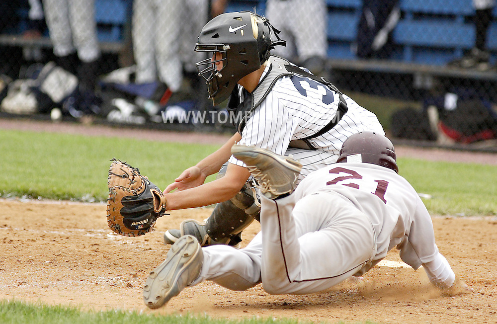 Kingston's Jerred Beniquez slides into home plate as Pine Bush catcher John Lindau waits for the throw in the Section 9 Class AA baseball championship game at Dietz Stadium in Kingston on Friday, June 1, 2012.