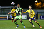 Forest Green Rovers Udoka Godwin-Malife(22) controls the ball under pressure from Coventry City's Zain Westbrooke(25) during the Leasing.com EFL Trophy match between Forest Green Rovers and Coventry City at the New Lawn, Forest Green, United Kingdom on 8 October 2019.