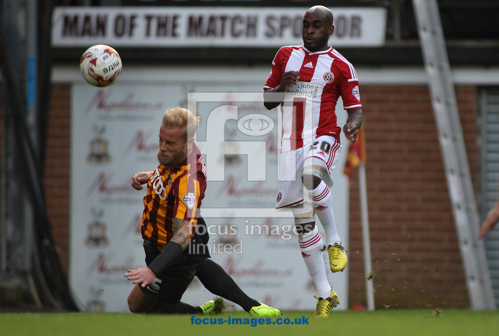 Andrew Davies (L) of Bradford City defends the cross from Jamal Campell-Ryce (R) of Sheffield United during the Sky Bet League 1 match at the Coral Windows Stadium, Bradford<br /> Picture by Stephen Gaunt/Focus Images Ltd +447904 833202<br /> 18/10/2014