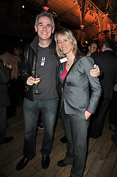 Writers CLIFF McNISH and LAUREN ST.JOHN at the annual Orion Publishing Group's Author party held in the Paul Hamlyn Hall, The Royal Opera House, Covent Garden, London on 15th February 2011.