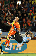 CAPE TOWN, SOUTH AFRICA- Tuesday 6 July 2010, Demy De Zeeuw gets kicked in the face by Martin Caceres during the semi final match between Uruguay and the Netherlands (Holland) held at the Cape Town Stadium in Green Point during the 2010 FIFA World Cup..Photo by Roger Sedres/Image SA