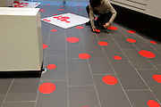 red dots placing for an art installation by Yayoi Kusama Japan Audi cars showroom