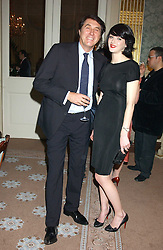 BRYAN FERRY and KATIE TURNER at a dinner hosted by Krug champagne at Claridge's, Brooke Street, London on 14th February 2006.<br /><br />NON EXCLUSIVE - WORLD RIGHTS