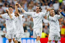 Goalscorer Gareth Bale of Real Madrid celebrates with teammates after Real Madrid win 1-0 to progress for the Champions League Final - Mandatory byline: Rogan Thomson/JMP - 04/05/2016 - FOOTBALL - Santiago Bernabeu Stadium - Madrid, Spain - Real Madrid v Manchester City - UEFA Champions League Semi Finals: Second Leg.
