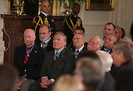 Medal of Honor winners watch as President Barack Obama presents the Medal of Honor to Staff Sargeant Salvatore Giunta.  The Ceremony was held in the East Room of the White House on November 16, 2010.  Photograph by Dennis Brack