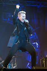 © Licensed to London News Pictures. 11/06/2015. Newport, UK.   Billy Idol performing live at Isle of Wight Festival 2015, headlining the Big Top on the first night Day 1 of the festival, Thursday.   In this picture - Photo credit : Richard Isaac/LNP