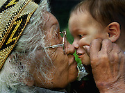 "Bertha Norton age 101, gives her great great grandson Joshua Ramirez 16 months, a pinch and a kiss. Bertha is from Miadu and Wintun tribes.  PIcture taken the California State Indian Museum while celebrating ""Gathering of Honored Elders""."