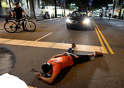 September 21, 2016 - Charlotte, North Carolina, U.S. - A protestor blocks an intersection at Trade and Tryon Streets. The protestors were rallying against the fatal shooting of Keith Lamont Scott by police on Tuesday evening in the University City area. (Credit Image: © Jeff Siner/TNS via ZUMA Wire)