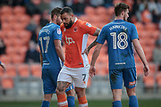 Kyle Vassell (Blackpool) takes a breather while the corner is about to be taken during the EFL Sky Bet League 2 match between Blackpool and Hartlepool United at Bloomfield Road, Blackpool, England on 25 March 2017. Photo by Mark P Doherty.