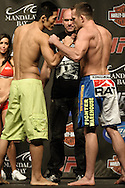 LAS VEGAS, NEVADA, JULY 10, 2009: Dony-Hyun Kim (left) and TJ Grant face off during the weigh-in for UFC 100 inside the Mandalay Bay Events Center in Las Vegas, Nevada