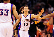 Feb. 9, 2012; Phoenix, AZ, USA; Phoenix Suns guard Steve Nash (13) is congratulated by teammates while playing against the Houston Rockets during the first half at the US Airways Center. The Rockets defeated the Suns 96-89. Mandatory Credit: Jennifer Stewart-US PRESSWIRE..