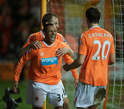 BLACKPOOL, ENGLAND - Tuesday, January 25, 2011: Blackpool's Dudley Campbell celebrates scoring the second goal against Manchester United with fellow goal-scorer Craig Cathcart during the Premiership match at Bloomfield Road. (Photo by David Rawcliffe/Propaganda)