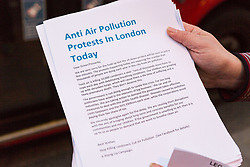 PICTURED: Protesters hand out leaflets to motorists explaining their actions.. Demonstrators from the anti-pollution group Stop Killing Londoners cause traffic chaos for London commuters as they conduct a series of short roadblocks at Marble Arch stopping cars and buses from entering Oxford Street and Park Lane. Irate motorists accused them of creating more pollution than they were stopping, whilst the group said their objectives were long term. A leaflet handed out to motorists says the government is not doing enough to tackle the crisis costing 'taxpayers and the NHS £billions [sic] a year'. PLACE, January 29 2018. © Paul Davey
