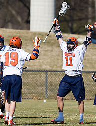 Virginia Cavaliers M George Huguely (11) celebrates after a UVA goal.  The #2 ranked Virginia Cavaliers defeated the Drexel Dragons 13-7 at the University of Virginia's Klockner Stadium in Charlottesville, VA on February 14, 2009.