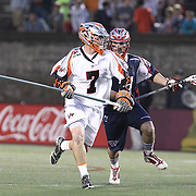 Matt Bocklet #7 of the Denver Outlaws runs with the ball during the game at Harvard Stadium on May 10, 2014 in Boston, Massachusetts. (Photo by Elan Kawesch)