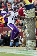 Minnesota Vikings wide receiver Stefon Diggs (14) leaps on the goal post, and draws an unsportsmanlike conduct penalty, as he celebrates after catching a second quarter touchdown pass good for a 14-10 Vikings lead during the 2017 NFL week 10 regular season football game against the Washington Redskins, Sunday, Nov. 12, 2017 in Landover, Md. The Vikings won the game 38-30. (©Paul Anthony Spinelli)