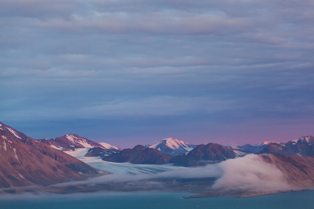 Gasbreen and surrounding mountains at sunset in Hornsund, Svalbard.