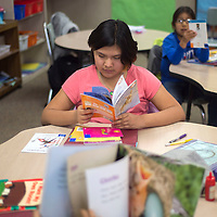 """Blessing Yazzie reads """"Footprints in the Snow"""" at Canyon de Chelly Elementary School in Chinle Wednesday."""