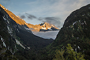 Sunrise shines on mountains near the Routeburn Track