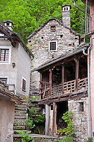 Ticino, Southern Switzerland. Courtyard in Moghegno with traditional, rustic buildings.