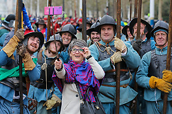 © Licensed to London News Pictures. 26/01/2020. London, UK. A tourist takes a selfie with the members of the English Civil War Society who are reenactoring the commemoration of the execution of Charles I, who was taken by the King's Army from St James Palace to the Banqueting House in Whitehall, for his execution on 30th January 1649. Photo credit: Dinendra Haria/LNP