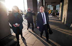 © Licensed to London News Pictures. 06/02/2018. London, UK. KEITH COCHRANE (right), interim chief executive of Carillion, being questioned by media as he arrives at Portcullis house in London where former bosses of the outsourcing firm Carillion are due to give evidence to a Business, Energy and Industrial Strategy Committee and the Work and Pensions Committe. Carillion plc, a major government contractor, went in to administration in January 2018. Photo credit: Ben Cawthra/LNP